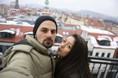 Halloween holiday celebration love couple. Love couple smile to camera at winter with snow in Germany