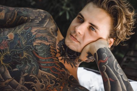 Photo for Portrait of handsome young man with tattoos - Royalty Free Image