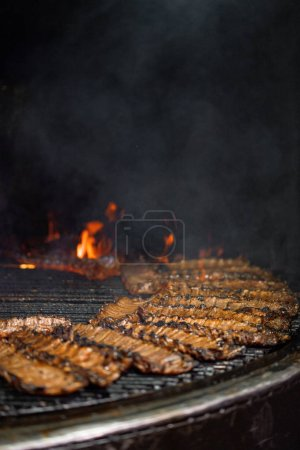 rib, rib restaurant, the process of preparing pork ribs on an open fire