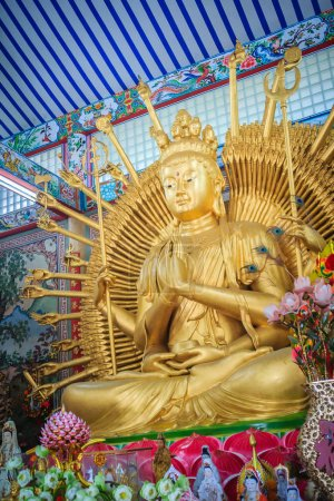 """Golden statue of Guan Yin with 1000 hands. Guanyin or Guan Yin is an East Asian bodhisattva associated with compassion as venerated by Mahayana Buddhists and known as the """"Goddess of Mercy"""" in English"""