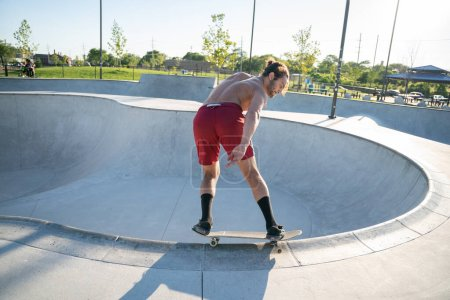 Photo for Detroit, Michigan, USA - 07.28.2020: Skaters practice tricks at an outdoor skatepark during the Corona Virus in Detroit. - Royalty Free Image