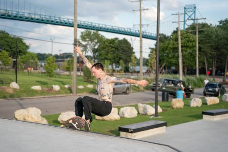 Photo for Detroit, Michigan, USA - 07.29.2020: Skaters and bikers practice tricks at an outdoor skate park during the Corona Virus in Detroit. - Royalty Free Image