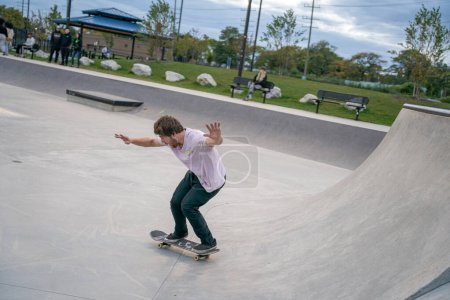Photo for Skaters are practicing tricks in an outdoor skate park in Detroit Michigan - Royalty Free Image