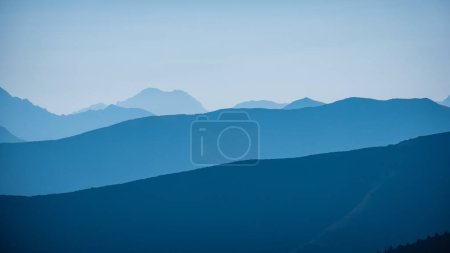 Photo for Western carpathian mountain tops in  autumn covered in mist or clouds with blue cast and multidimensional lines - Royalty Free Image