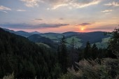 beautiful sunset in the mountains of Tatra, slovakia. hill tops with red clouds over them.  Western carpathian