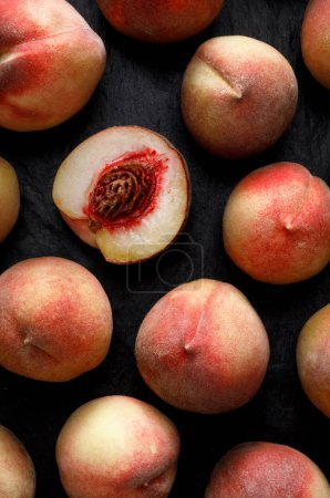 Photo for Peaches on a black background, top view, Fresh fruits from organic cultivation - Royalty Free Image
