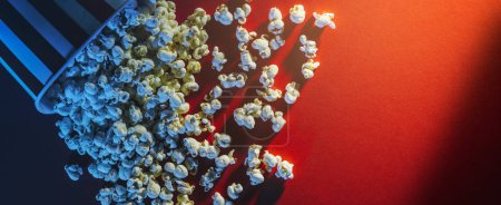 Spilled popcorn on a red background, cinema, movies and entertainment concept