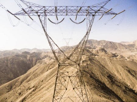 Photo for Aerial image of power line tower in Lima Peru. desert hills of the andes. - Royalty Free Image