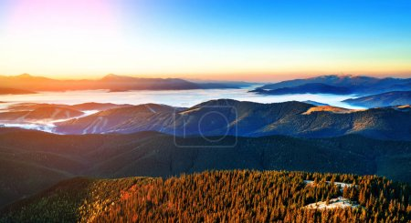 Photo for Beautiful dawn in the mountain range. Mountains shrouded in mist in a scenic landscape view. Location Carpathian mountains, Europe. Travel background - Royalty Free Image