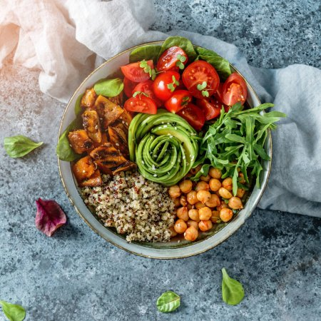Photo for Buddha bowl salad with baked sweet potatoes, chickpeas, quinoa, tomatoes, arugula, avocado, sprouts on light blue background with napkin. Healthy vegan food, clean eating, dieting, top view - Royalty Free Image