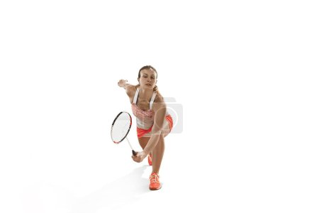 Photo for Young woman playing badminton over white studio background. Fit female athlete isolated on white. badminton player in action, motion, movement. attack and defense concept - Royalty Free Image
