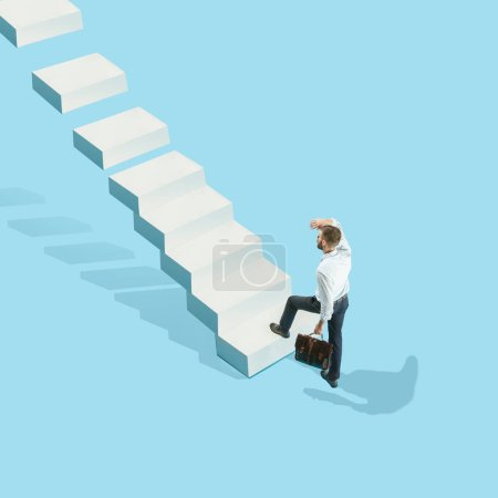Photo for Businessman with briefcase in hand, rising up the career ladder. Flat isometric view of man going up with empty copy space. Office, career concept. Business concepts. Miniature people. Collage - Royalty Free Image