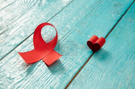Photo for Aids Awareness Sign Red Ribbons on blue wooden background . World Aids Day concept. The health, help, care, support, hope, illness, healthcare concept - Royalty Free Image