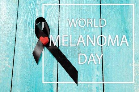 Photo pour Ruban noir-symbole de la lutte contre le cancer du mélanome et de la peau. Le cancer, santé, sein, sensibilisation, campagne, maladies, aide, soins, soutien, espoir maladie survivor concept de soins de santé - image libre de droit