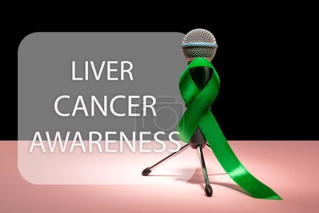 Photo for Liver Cancer and Hepatitis B - HVB Awareness month ribbon, Emerald Green or Jade ribbon awareness color on pink background. The cancer, health, help, care, support, hope, illness, survivor, healthcare - Royalty Free Image