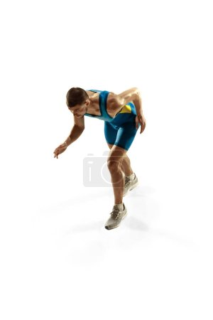 Photo for Young caucasian man preparing to run isolated on white studio background. One male runner or jogger. Silhouette of jogging athlete with shadows. - Royalty Free Image