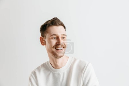 Photo for Happy business man standing, smiling isolated on gray studio background. Beautiful male half-length portrait. Young satisfy man. Human emotions, facial expression concept. - Royalty Free Image