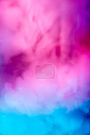Photo for Abstract colorful, multicolored smoke spreading, bright background for advertising or design, wallpaper for gadget. Neon lighted smoke texture, blowing clouds. Modern designed. - Royalty Free Image