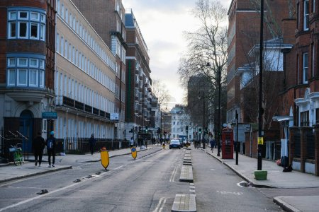 Photo pour London, UK - March 1, 2020: A view along a street with a road and separate cycle lanes in London, UK. - image libre de droit