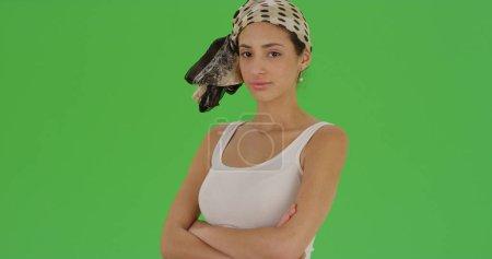 Hispanic woman posing for a portrait wearing a bandana on green screen