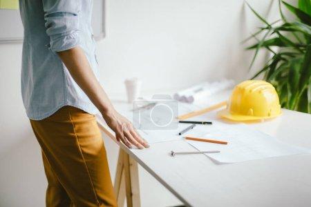 Woman architect draws a plan, design, geometric sh...