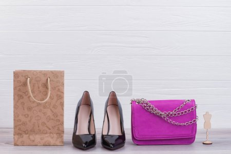 Female shoes, handbag and shopping bag.