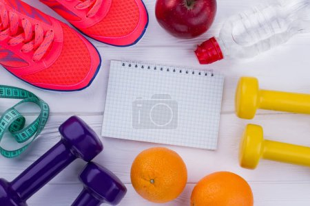 Photo for Fitness equipment, healthy food and notebook. Healthy and active lifestyle. Diet plan concept. - Royalty Free Image