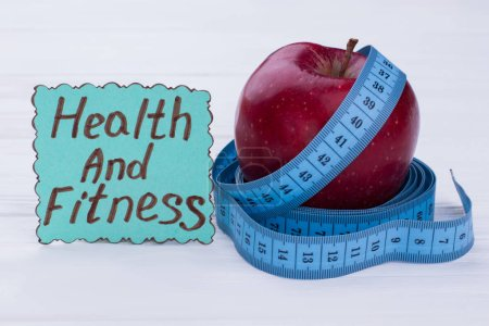 Photo for Health and fitness concept. Fresh apple and measuring tape. Healthy eating and diet. - Royalty Free Image