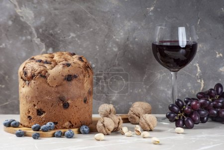 Photo for Christmas panettone cake, glass wine with raisins and fruits. Traditional Italian dish. - Royalty Free Image