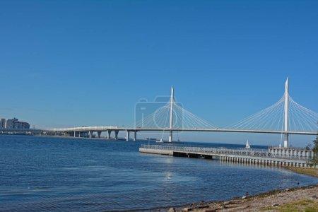 Vansu bridge. Across a large river against a bright, clear, blue sky