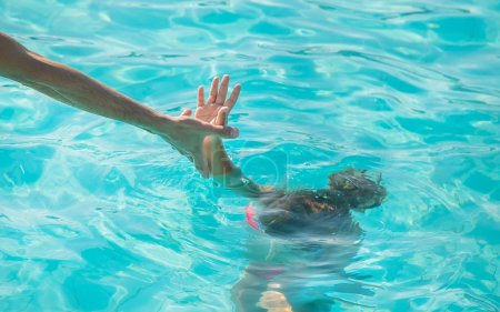 Kid is drowning in the sea. Selective focus. natur...