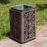 Beautiful forged metal urn on the sidewalk...