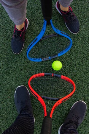 Photo for Tennis rackets with ball on green grass background - Royalty Free Image