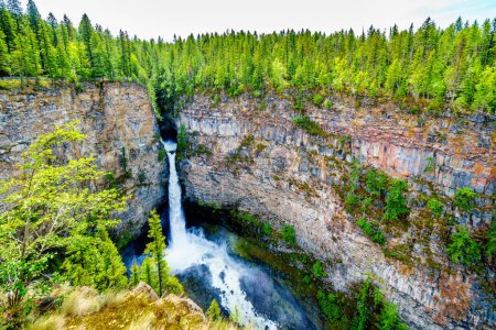 The beautiful Spahats Falls in Wells Gray Provincial Park, BC, Canada, flows over a lava bed to a 75 meter drop into the Spahats Creek below.
