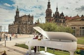 Dresden, Germany - August 4, 2017: The pianist plays the piano at the Theater Square of Dresden