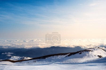 Photo for Sea of clouds view from the top of snowy mountain, concept of winter sports in nature - Royalty Free Image