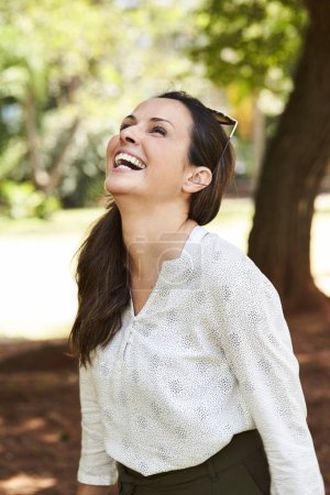Laughing and carefree woman in park