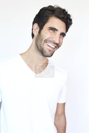 Happy man in white t-shirt, looking away