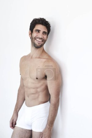 Photo for Man laughing in white undershorts - Royalty Free Image