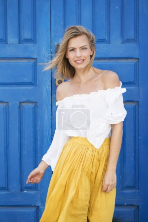 Blue eyed model in white and yellow fashion, portrait