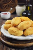 French cuisine. Pomme dauphine: deep-frying crisp potato puffs  from mashed potatoes