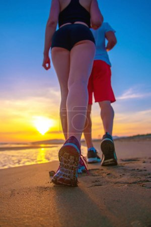 Photo for Bottom low section view of couple walking by beach - Royalty Free Image