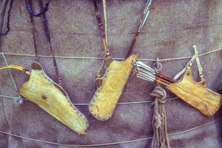 Quivers with vintage bows hanging on the wall of t...