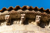 Corbels in the cornice of the apse of a Romanesque church