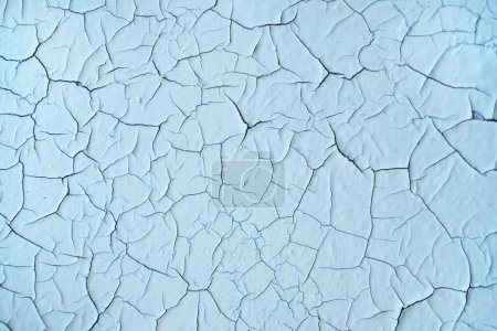 Photo for Texture of cracked blue paint. Peeling texture on the wall. Pattern of rustic grunge material. - Royalty Free Image