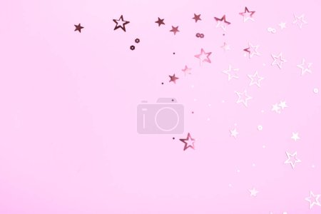 Golden stars on pink background. Festive mood. Overview