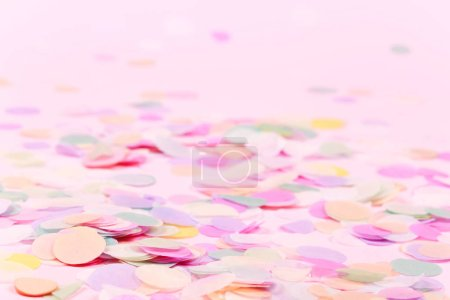 Photo for Vibrant confetti on pastel pink background. Festive backdrop for your design. - Royalty Free Image