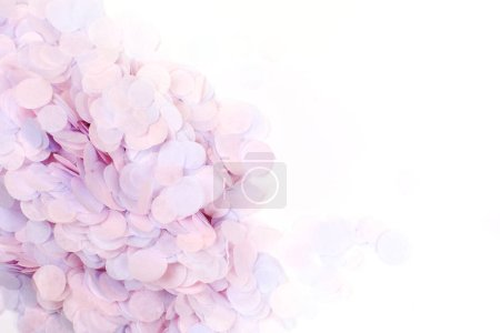Photo for Pink pastel confetti on white background. Festive backdrop for your design. - Royalty Free Image