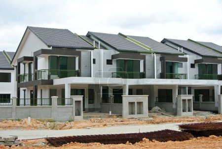 Photo for SEREMBAN, MALAYSIA -APRIL 09, 2020: New double story luxury terrace house under construction in Malaysia.  Designed by an architect with a modern and contemporary style. - Royalty Free Image