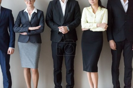 Photo for Close up group of multi-ethnic professionals candidates business people standing together young and mature, waiting for interview. In row confident company worker staff successful team people concept - Royalty Free Image